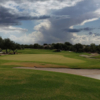 A cloudy day view of a hole at Terravita Golf Club.