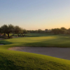 A sunset view of a green at Terravita Golf Club.