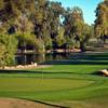A view of a green with water coming into play at Mesa Country Club.