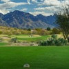 A view from a tee at MountainView Country Club with mountains in the distance.