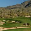 A view of a hole protected by tricky bunkers from Geronimo Course at Desert Mountain Golf Club
