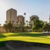 A sunny day view of a well protected hole at Phoenix Country Club.