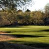 A sunny day view of a hole at San Ignacio Golf Club.