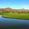 A view over the water of a green at Rancho Manana Golf Club.